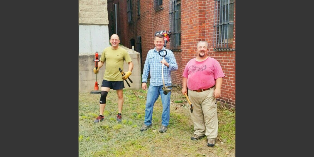 Volunteers Tackle Varnum Armory Exterior Cleanup