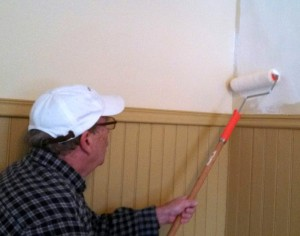 The Meeting Room at Varnum House is getting spruced up for spring. Here, Trustee Bill Weaver applies a fresh coat of paint.