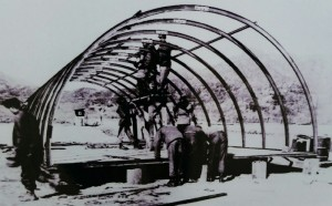 Quonset hut being constructed.