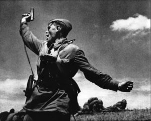 Soviet officer Alexey Yeremenko leading his men into combat with a Tokarev TT-33.