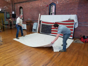 Mounting the first US Flag to enter Germany after World War I Armistice