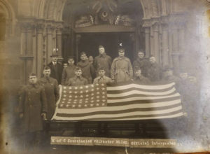 Knights of Columbus pose with the first US Flag to enter Germany after World War I Armistice