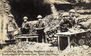 Salvation Army making doughnuts under bombardment of German guns in France.