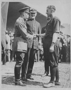 King George V, Admiral Sims, and Chief Yeoman Mike McNally of the Army-Navy Baseball Team on July 4, 1918, in London. About 70,000 attended.