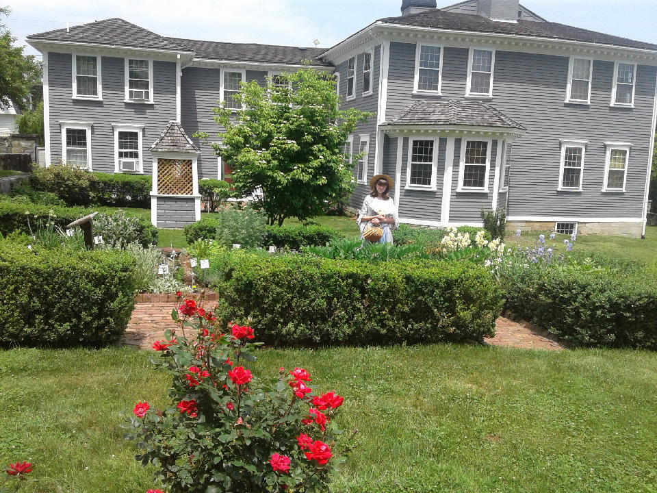 A young docent in the Varnum House period garden.